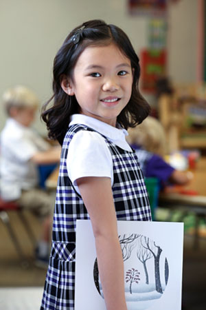 CHCA Lower School Student Holding Picture